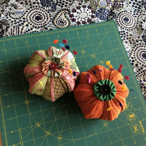 two pincushions with pins