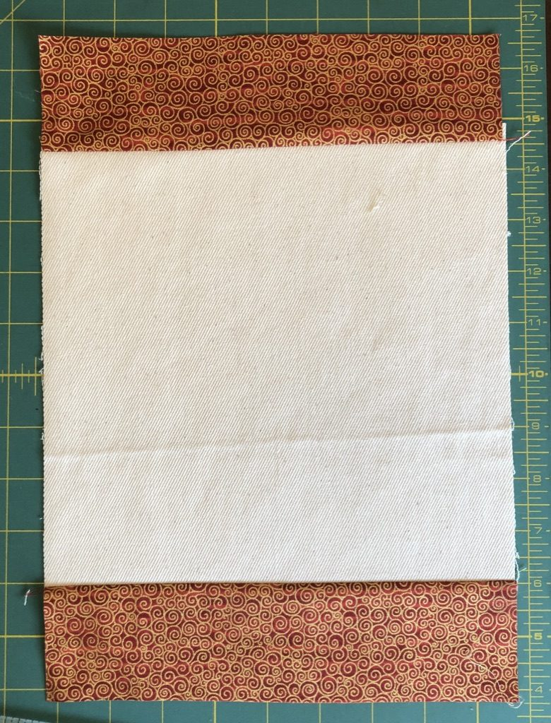 adding strips 1 to the placemat for christmas